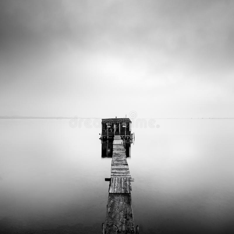 Minimal seascape with fishing hut royalty free stock photos