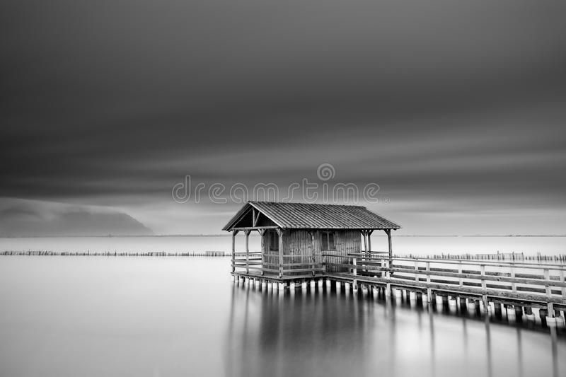 Minimal seascape with fishing hut royalty free stock photography