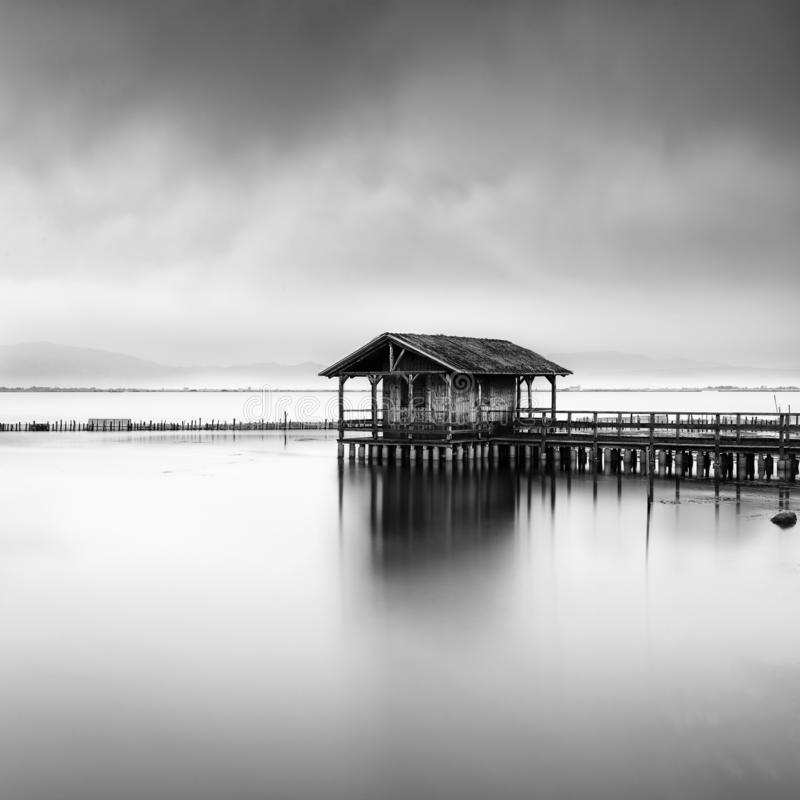 Minimal seascape with fishing hut stock photography