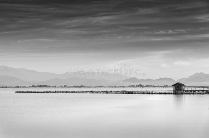 Minimal seascape with fishing hut stock images