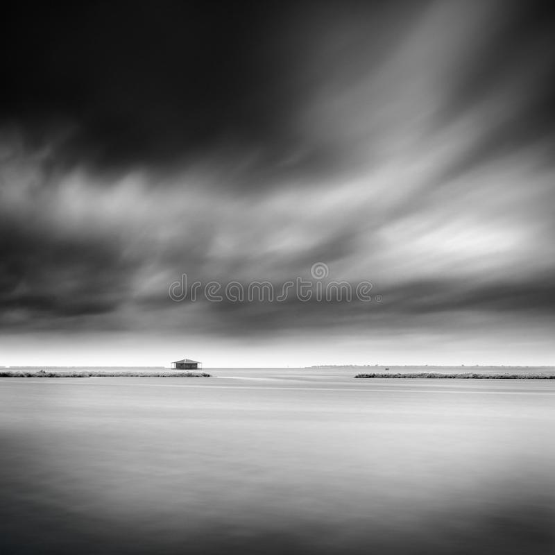 Minimal seascape with fishing hut stock photo