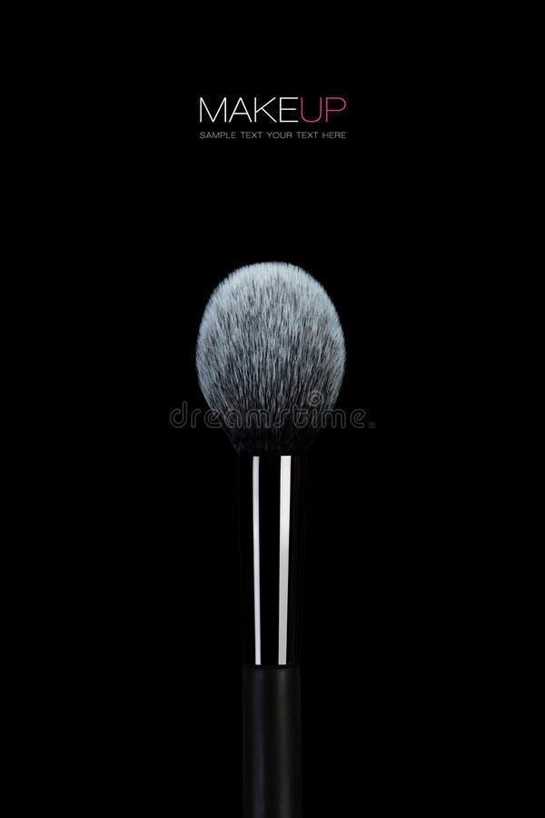Fine art Makeup concept. Soft bristle cosmetics brush. Fine art Makeup concept with a close up of a professional make-up brush with soft bristle and the tip royalty free stock photos