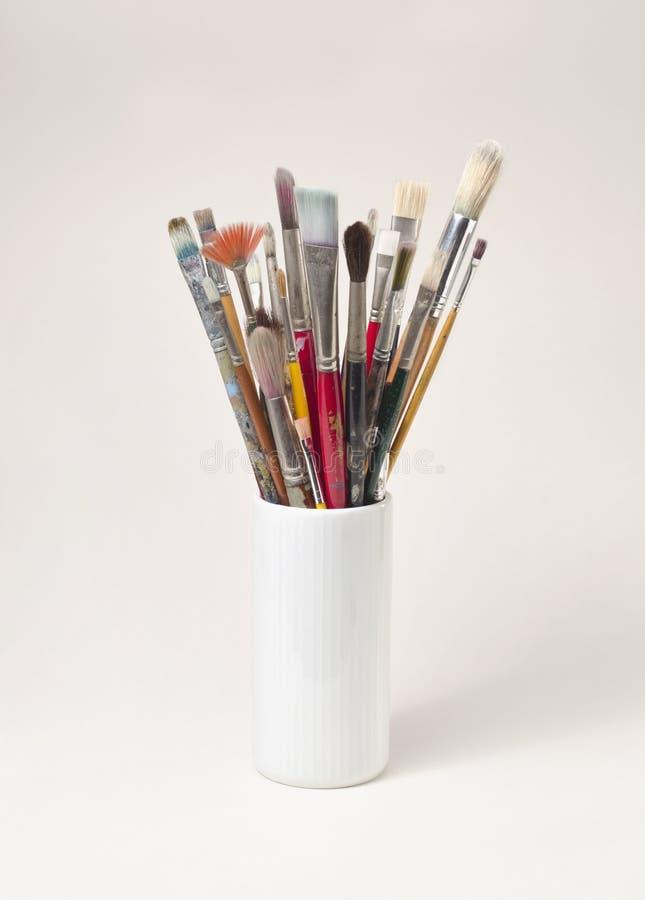 Fine art paint brushes. Canister of multiple fine art brushes stock photo