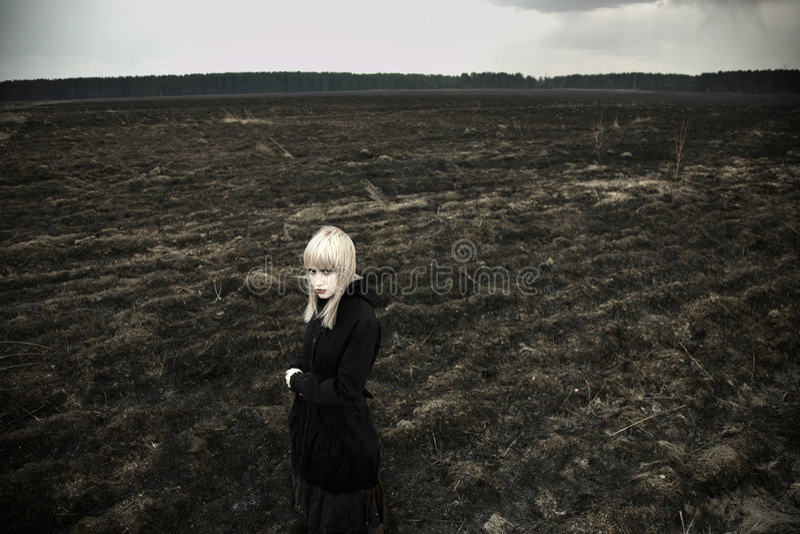 Fine art portrait of girl on black field royalty free stock photography