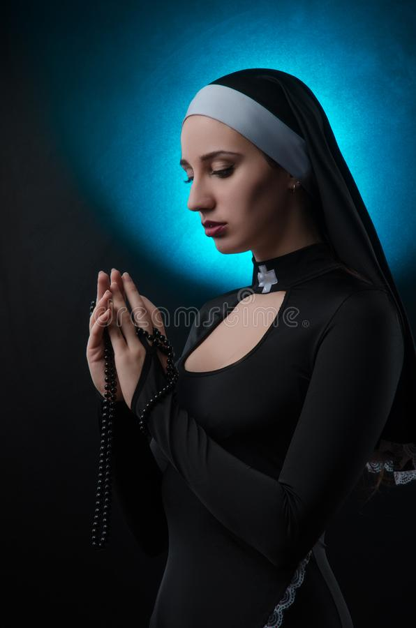 Free Fine Art Portrait Of A Novice Nun In Deep Prayer With Rosary Stock Image - 136342021