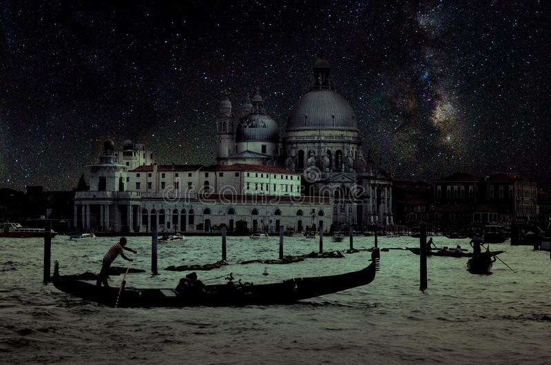 Fine art retro image with gondola on Canal Grande at night with wood planks floor for foreground, full moon and milky, Venice, It. Aly royalty free stock photos