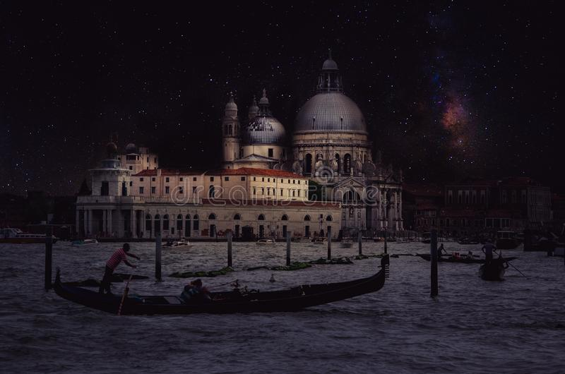 Fine art retro image with gondola on Canal Grande at night with wood planks floor for foreground, full moon and milky, Venice, It. Aly royalty free stock image