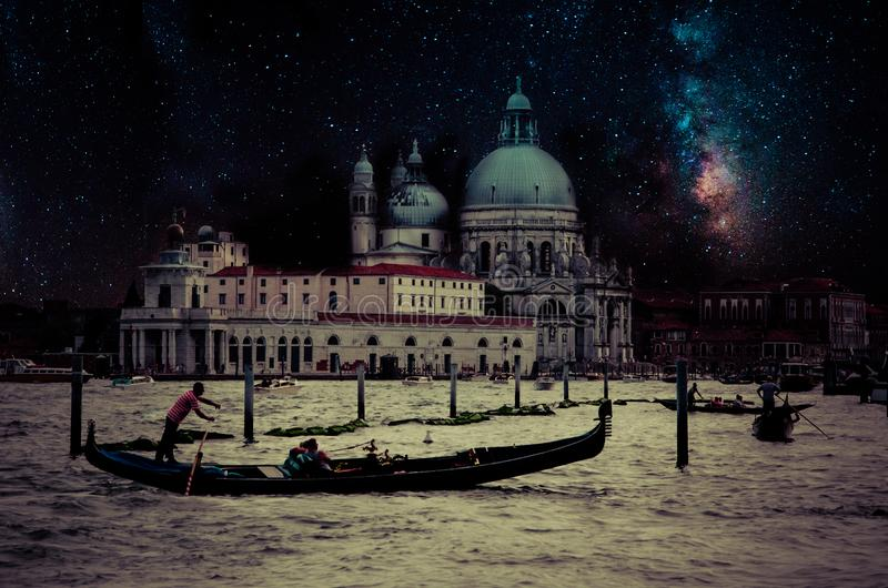 Fine art retro image with gondola on Canal Grande at night with wood planks floor for foreground, full moon and milky, Venice, It royalty free stock images