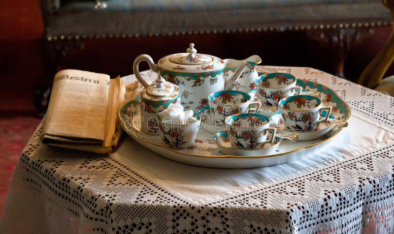 Fine China tea set and paper royalty free stock image