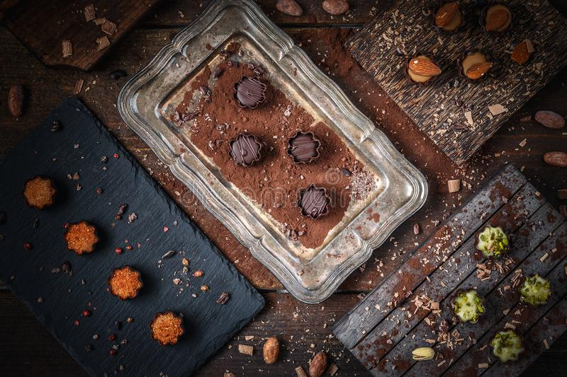 Fine chocolate pralines. Small irresistible chocolate pralines with different fillings royalty free stock photo