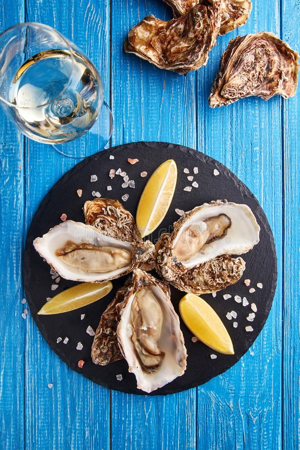 Fine de claire oysters with lemon and white wine royalty free stock photos