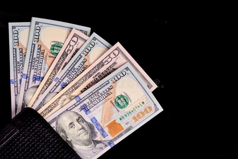 Fine del denaro contante del dollaro su in grandi numeri fotografia stock libera da diritti