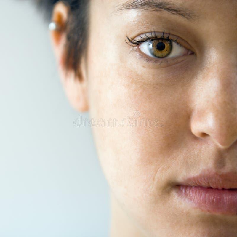 Fine del fronte della donna in su immagini stock libere da diritti