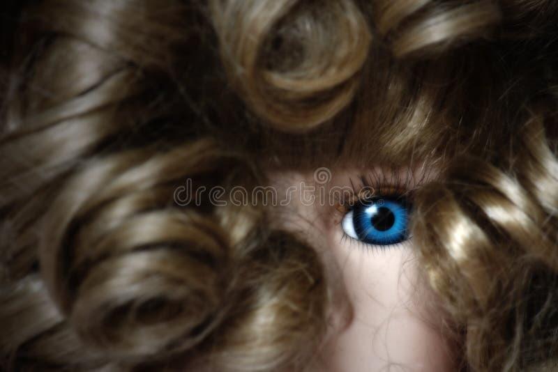 Fine dell'occhio della bambola in su immagine stock libera da diritti