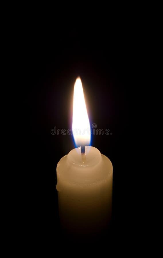 Fine della fiamma di candela in su immagini stock