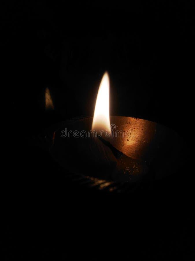 Fine della luce della lampada del fuoco su fotografia stock