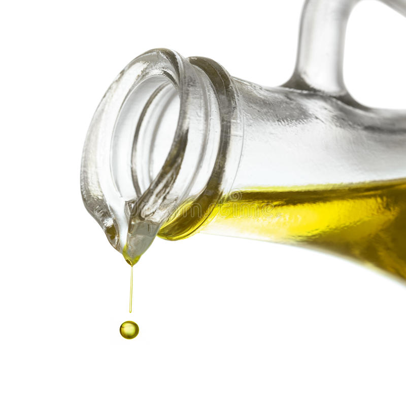 Fine di goccia dell'olio di oliva su fotografie stock