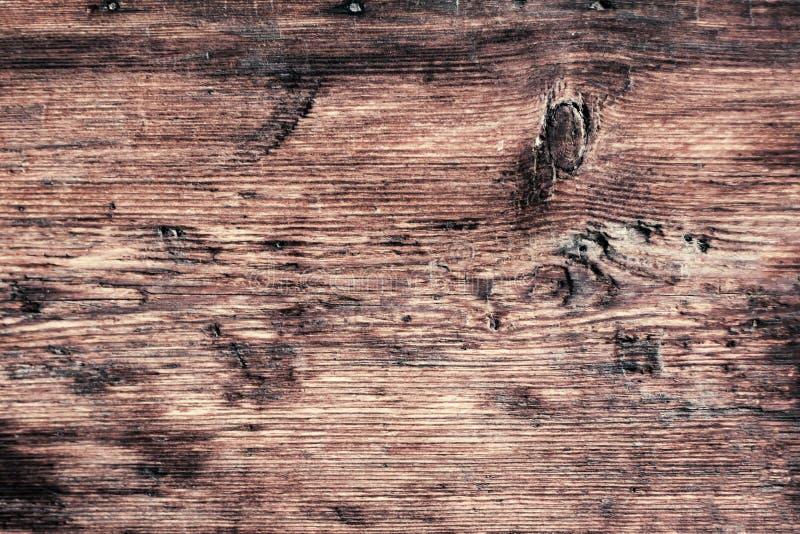 Fine di legno d'annata scura di struttura su macro retro fotografia stock
