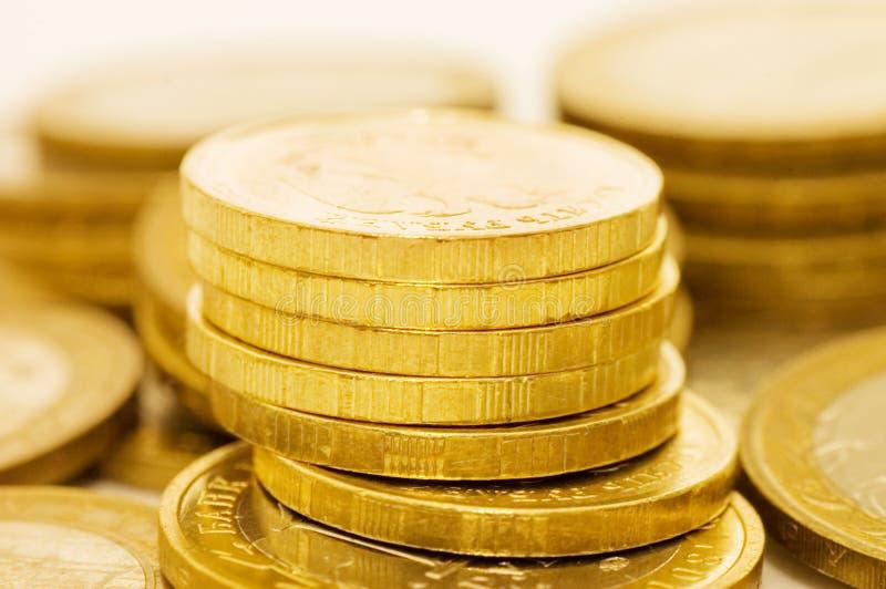 Fine di macro delle monete in su fotografie stock libere da diritti