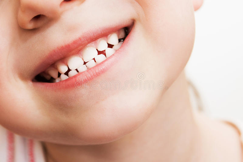 Fine di sorriso del bambino fotografia stock libera da diritti