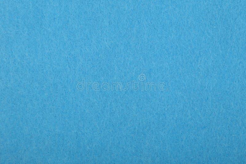 Fine di struttura del fondo del feltro del blu su immagini stock libere da diritti