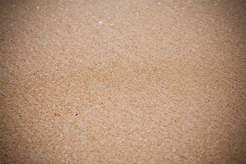 Fine di struttura della spiaggia di sabbia su fotografia stock