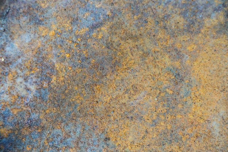 Fine di superficie arrugginita di immagine di struttura del metallo su per terra posteriore fotografia stock