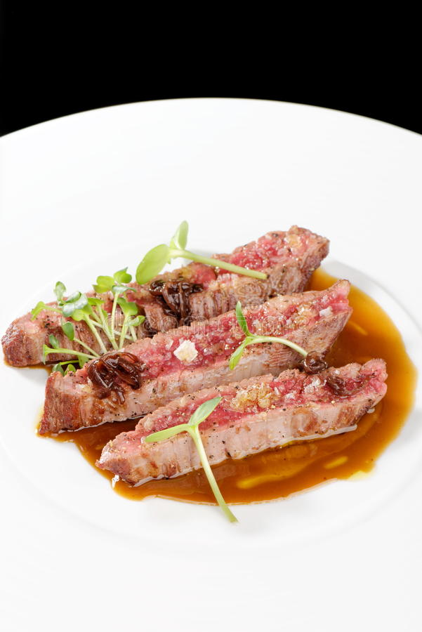 Fine dining, Angus Beef Steak fillets. With Roasted tomato/Pepper Sauce stock photography