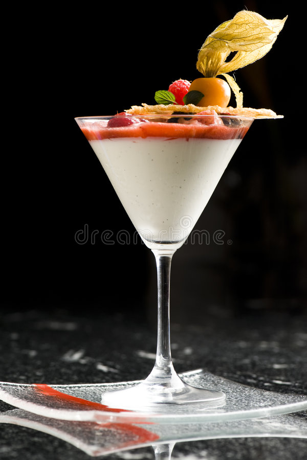 Fine dining dessert cocktail with fruit toppings royalty free stock image