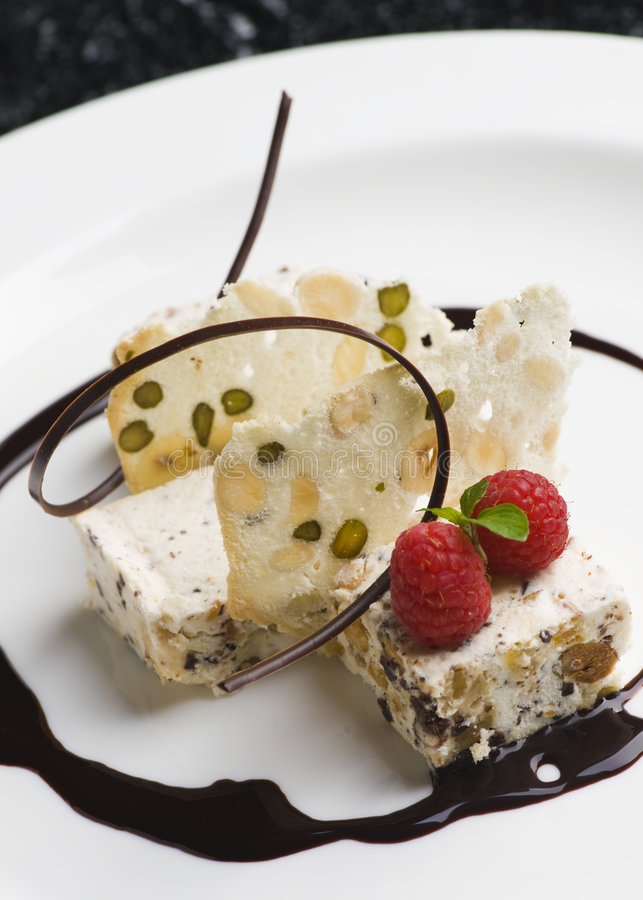 Fine dining dessert with raspberry and chocolate
