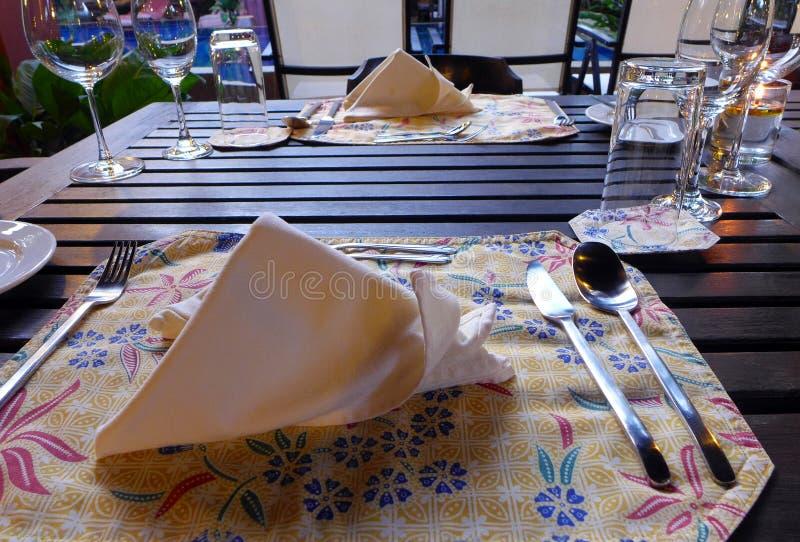 Fine dining Elegant table setting, ethnic batik stock photo
