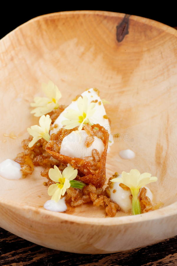 Fine dining, Vanilla ice cream with almond crust stock images