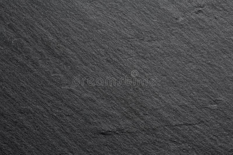 Fine estrema su della struttura di un bordo di pietra scuro della cucina fotografie stock