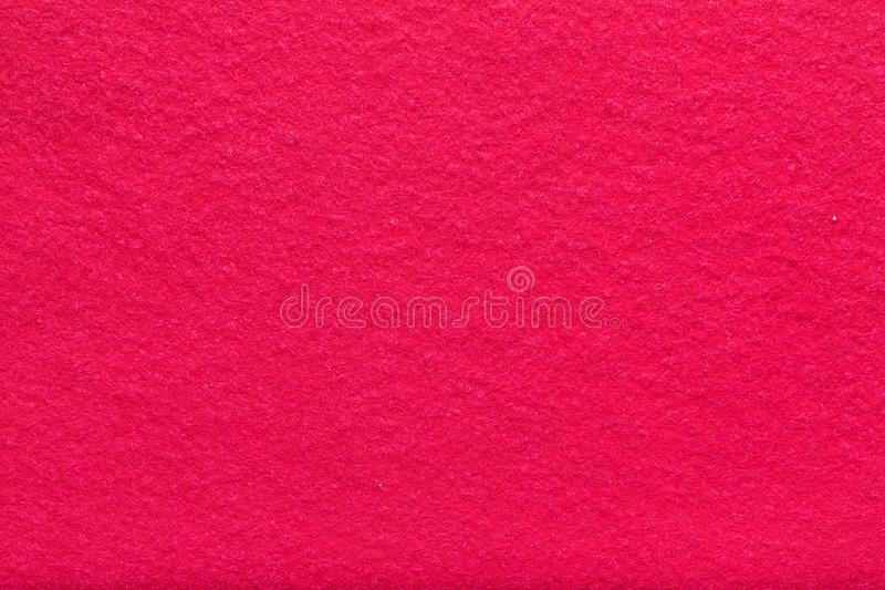 Fine grain coral red woolen felt. Texture background. Velvet scarlet matte background of suede fabric royalty free stock photos