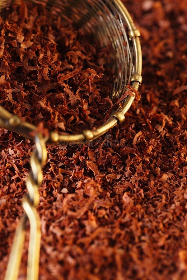 Fine Grated Chocolate 100  Dark In Sieve Stock Photo