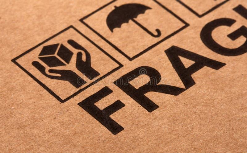Fine image close up of fragile symbol on cardboard stock images