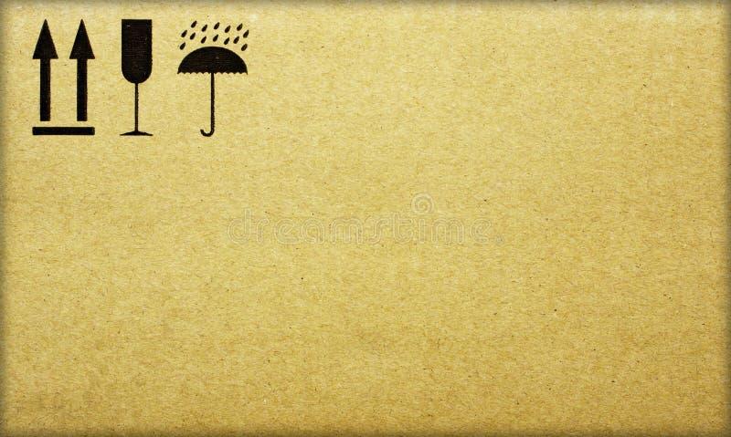 Fine image close-up of grunge black fragile symbol on cardboard stock images
