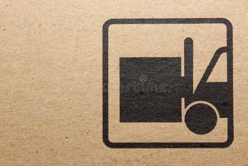 Fine image close-up of grunge black fragile symbol on cardboard royalty free stock photos