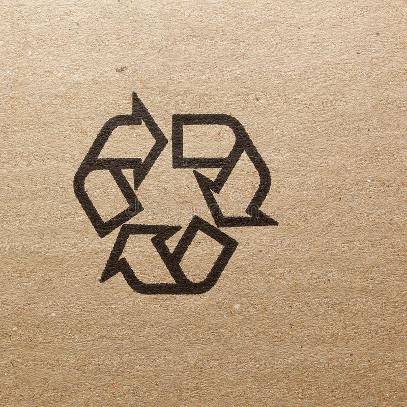 Fine image close-up of grunge black fragile symbol on cardboard royalty free stock photo