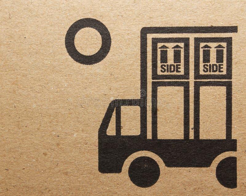 Fine image close-up of grunge black fragile symbol on cardboard royalty free stock photography