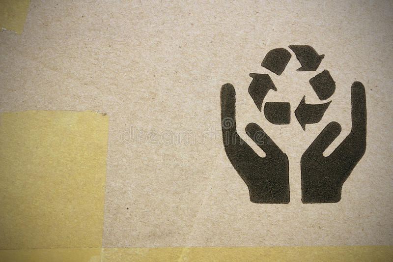 Fine image close-up of grunge black fragile symbol on cardboard.  royalty free stock photos