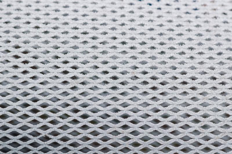 Fine mesh covered with white hoarfrost stock images
