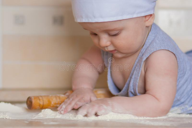 Fine motor skills. development of the. Child through cooking. child and flour. a child sculpts a pea from royalty free stock images