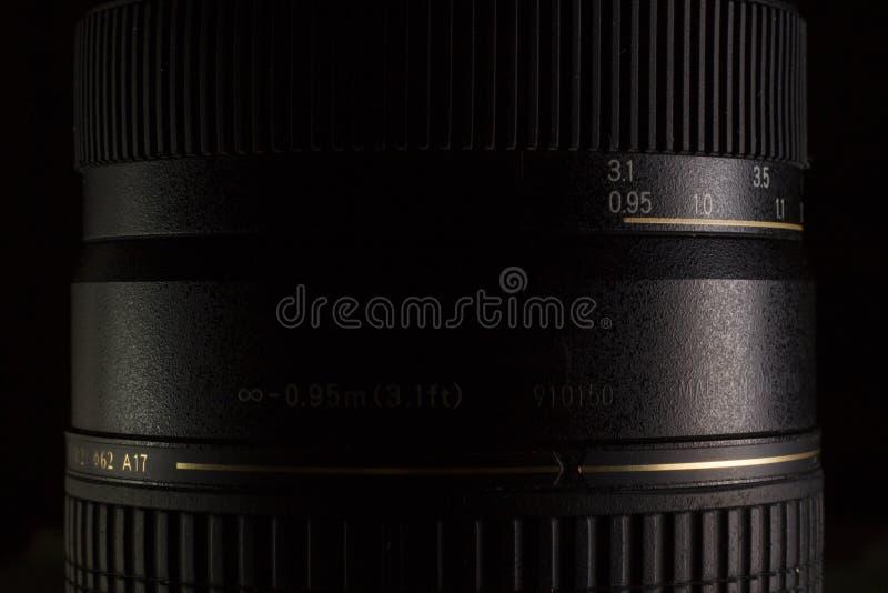Fine nera dello zoom del teleobiettivo di DSLR su fotografia stock