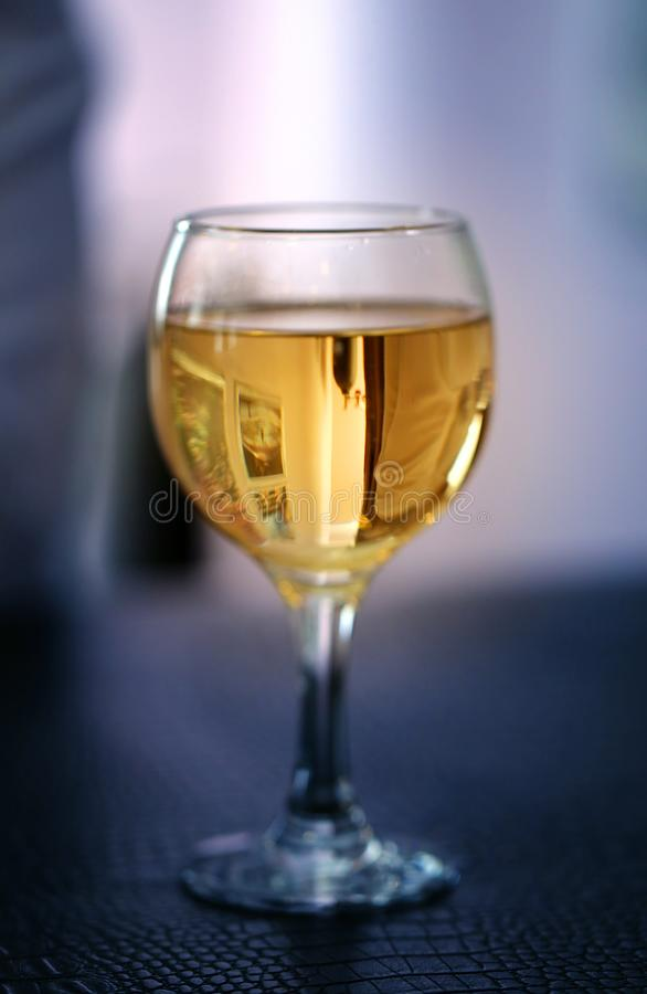 Fine photo bright tasty wine in a transparent glass royalty free stock photo