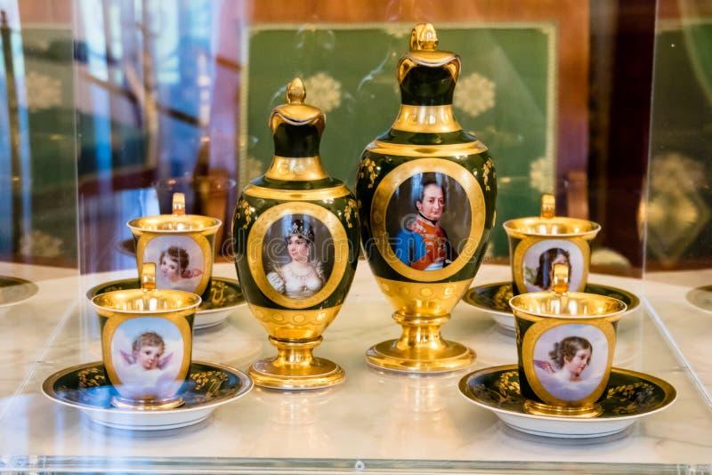 Fine porcelain tea set with family portraits stock photos