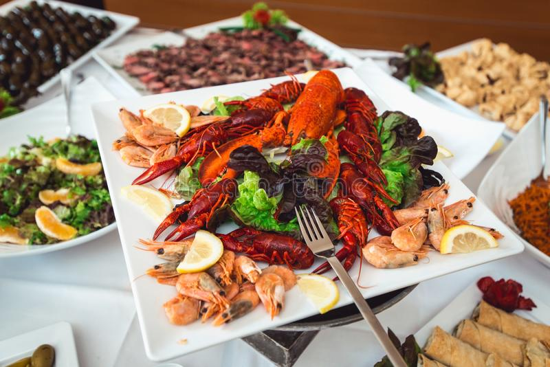 Fine selection of crustacean for dinner. Lobster, crab and jumbo shrimp on a white plate.  royalty free stock photo