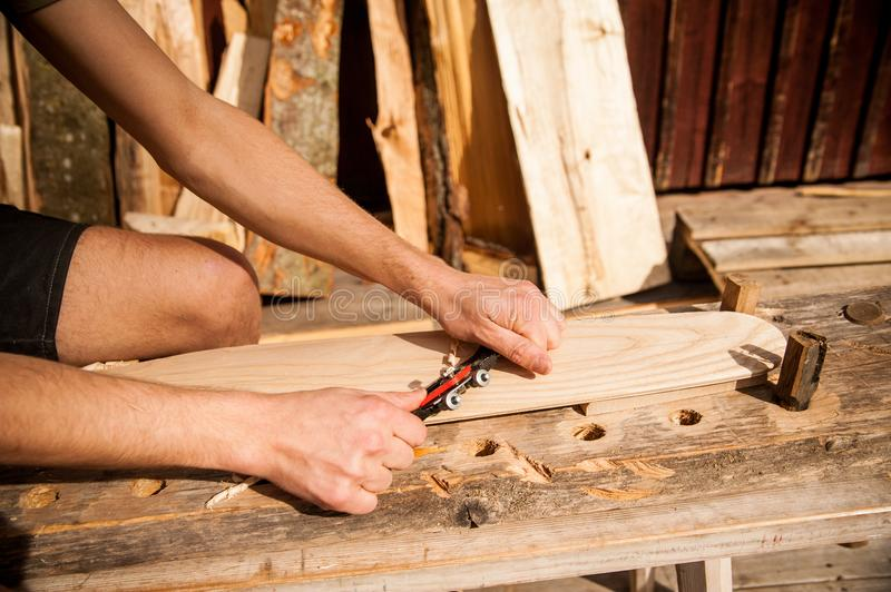 Using a spokeshave outdoors stock image