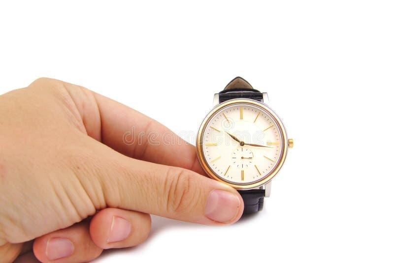 Fine su dell'orologio della tenuta della mano, isolato su fondo bianco Cronometri il concetto fotografia stock libera da diritti