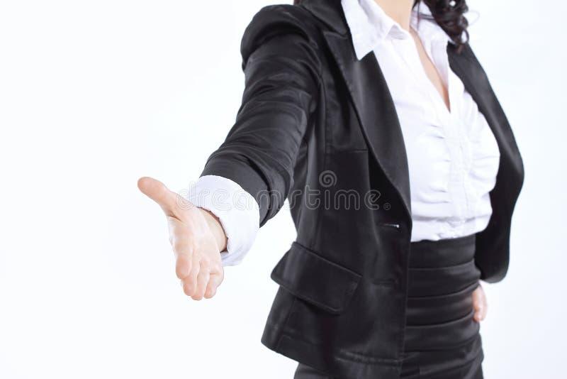 Fine in su donna di affari della mano distesa per la stretta di mano Isolato su bianco fotografie stock